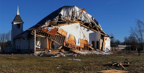 The back of Shiloh Baptist Church was crushed in Robertsville, Mo. A storm struck New Year's Eve.