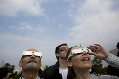 Skywatchers use eye protection to view the first partial solar eclipse of the year in Givatayim, Israel on Jan. 4.