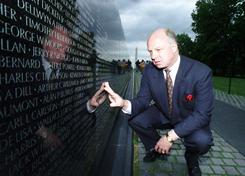 John Wheeler III, who had a prominent role in getting the Vietnam Veterans Memorial built in the 1980s, touches the name of a friend engraved in the memorial in Washington. Wheeler's body was discovered Dec. 31 as a waste management truck emptied its contents at a landfill in Delaware