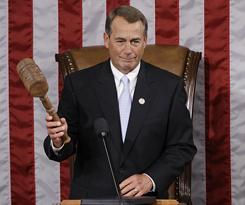 House Speaker John Boehner of Ohio holds up a gavel during the first session of the 112th Congress Wednesday in Washington.