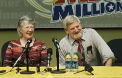 Jim and Carolyn McCullar, of Ephrata, Wash., who bought one of two winning Mega Millions lottery jackpot tickets, talk to reporters Thursday. The McCullars will split the $380 million prize with another person who purchased a ticket in Idaho but has not yet come forward.