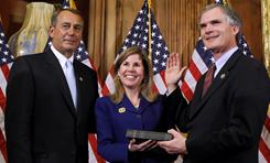 House Speaker John Boehner of Ohio, left, administers the House oath to Rep. Robert Latta, R-Ohio, during a mock swearing-in ceremony Wednesday on Capitol Hill in Washington.