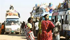 Southern Sudanese families wait Thursday to board buses in Khartoum and return to their homeland ahead of a vote on south Sudan's independence. There are eight polling sites in the U.S.