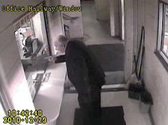 This surveillance video shot shows John P. Wheeler III inside a courthouse parking garage Dec. 29.