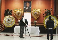 "A  shrine is set up for a memorial at the Lao Family Center in St. Paul, Minn., in honor of Vang Pao on Friday. Pao, a fabled military hero and beloved father figure among the international Hmong refugee community, will be honored with a massive funeral ""fit for a king"" in central California, the general's son said."