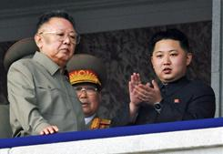 In this Oct. 10 file photo, North Korea leader Kim Jong Il, left, walks by his son Kim Jong Un on the balcony as they attend a massive military parade marking the 65th anniversary of the communist nation's ruling Workers' Party in Pyongyang, North Korea. On Saturday, North Korea proposed unconditional talks with South Korea.