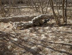 Spc. Ryan Hernandez, from 1-320 Field Artillery Regiment, 2nd Brigade Combat team, 101st Airborne Division, takes a position during a patrol Thursday in Kandahar, Afghanistan.