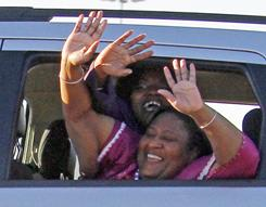 Jamie, foreground, and Gladys Scott wave from a vehicle as they leave the Central Mississippi Correctional Facility in Pearl, Miss., Friday.