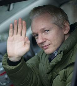 WikiLeaks founder Julian Assange waves from his car in Norfolk, England, in December. U.S. officials have subpoenaed Twitter demanding details about the accounts of Assange and Army Pfc. Bradley Manning.