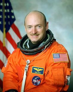 A file photo shows Mark Kelly, husband of Rep. Gabrielle Giffords, who survived being shot in the head on Saturday. Kelly is scheduled to command a shuttle mission in less than three months.