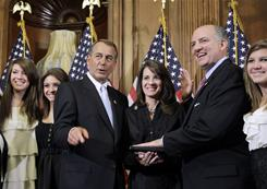 "House Speaker John Boehner of Ohio participates in a ceremonial swearing in with Rep. Steve Southerland, R-Fla., on Jan. 5. Southerland said the attack, which critically wounded Giffords, ""has no place in our democracy and was nothing short of an assault on our values."""