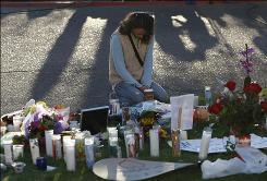 Patty Atkins prays early Sunday morning at a University Medical Center vigil for Rep. Gabrielle Giffords and other victims of Saturday's shooting in Tucson.
