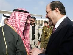 Iraqi Prime Minister Nuri al-Maliki, right, greets Kuwaiti Prime Minister Sheik Nasser Al-Mohammed Al-Sabah in Baghdad on Jan. 12, 2011. Al-Sabah's arrival in Baghdad marks the first visit by a Kuwaiti prime minister since the 1991 Gulf War.