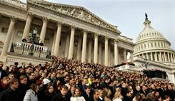A crowd including members of Congress and their staffs gather Monday on the East Steps of the House of Representatives for a national moment of silence.