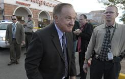 "Pima County Sherriff Clarence Dupnik visits the site of the shooting rampage. ""We're the Tombstone of the United States,"" he has said."