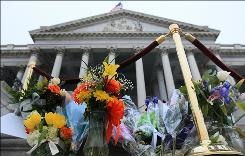 Flowers left by well-wishers are stacked on the center steps of the U.S. Capitol to honor the victims of Saturday's mass shooting in Arizona in which Rep. Gabrielle Giffords, D-Ariz., was injured.