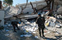 United Nations troops inspect the Hotel Montana in Port-au-Prince on Jan 15, 2010.