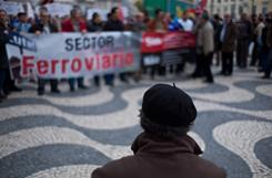 "Portuguese railway workers gather for a demonstration Wednesday in Lisbon. The workers were protesting unemployment and the government's austerity measures aimed controlling the country's current financial crisis. Banner reads ""railway sector""."