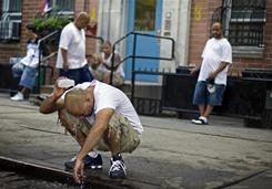 Jose Cruz, 32, of Manhattan's Lower East Side escapes the heat by dousing himself with water flowing down the street from an open fire hydrant in New York on July 24, 2010. According to the National Climatic Data Center, 2010 tied with 2005 as the warmest year on record for global surface temperature.