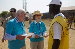 Former President Jimmy Carter and his wife, Rosalynn, chat with polling staff outside of a referendum voting station in the southern capital of Juba on Sunday.