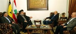 In this handout picture released by the Hezbollah press office, shows from left, Hezbollah coordinator Wafic Safa, Secretary General Hassan Nasrallah, Druze leader Walid Jumblatt and Minister of Public Works and Transportation Ghazi Aridi meet at an undisclosed place on Thursday.