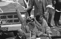 In this 1981 photo, Barry Rosen, who had been held hostage at the U.S. Embassy in Tehran, waves to the crowd while seated next to his wife, Barbara, during a tickertape parade in New York to welcome the hostages home.