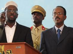 In this Nov. 1, 2010 file photo, Somali President Sheik Sheriff Sheik Ahmed, left, addresses officials following the swearing in of the newly-approved Somali Prime Minister Mohamed Abdullahi Mohamed, right. Mohamed, a Somali-American educator, said Wednesday that increased U.S. and international support for his government is essential to end Somalia's lawlessness and prevent terrorists from continuing to use the country as a safe haven.