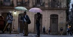 Students walk through Old Havana, Cuba, on Friday. The Obama administration aims to loosen Cuba travel restrictions.
