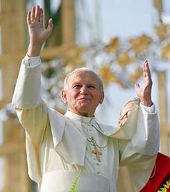 Pope John Paul II waves to a crowd in Krakow, Poland, in 1987. John Paul II is to be beatified on May 1, the Vatican announced Friday.