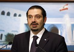Caretaker Prime Minister Saad Hariri, speaks during a press conference after meeting Lebanese President Michel Suleiman at the Presidential Palace in Baabda, east of Beirut, Lebanon on Friday. Hariri returned home Friday to a deepening political crisis two days after a Hezbollah-led coalition toppled his Western-backed government.