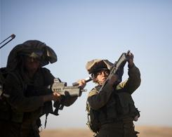 A female soldier from the mixed-sex battalion Karakal trains near the Israeli-Egyptian border on Dec. 14.