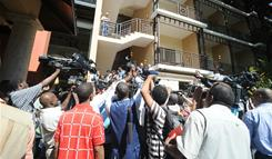 Journalists gather Monday at Karibe Hotel in Port-au-Prince, Haiti. Ex-dictator Jean-Claude Duvalier holed up in the high-end hotel.