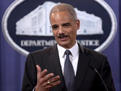 U.S. Attorney General Eric Holder participates in a news conference at the Justice Department last month.