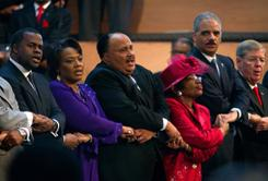 "From left: Atlanta Mayor Kasim Reed; the Rev. Bernice King and Martin Luther King III, daughter and son of Martin Luther King Jr.; Christine King Farris, sister of Martin Luther King Jr.; U.S. Attorney General Eric Holder; and Sen. Johnny Isakson, R-Ga.. The group sang ""We Shall Overcome"" during a service at Ebenezer Baptist Church honoring the 25th federal observance of Martin Luther King Jr. Day on Monday in Atlanta."