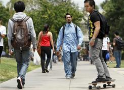 Students walk around the University of California's Riverside campus last June. 