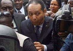 "Former Haitian dictator Jean-Claude ""Baby Doc"" Duvalier arrives at the courthouse with a police escort in Port-au-Prince on Tuesday."