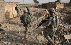 U.S. soldiers search for caches of weapons in the Hurriyah neighborhood of Baghdad.