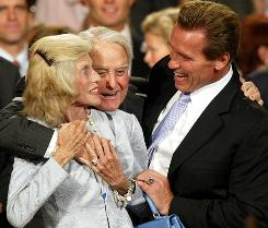 California Gov. Arnold Schwarzenegger, right, celebrates with mother-in-law Eunice Kennedy Shriver, left, and her husband, Sargent Shriver, at his victory party in the gubernatorial recall election on Oct. 7, 2003.