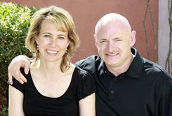 Mark Kelly poses with his wife, Rep. Gabrielle Giffords. Kelly says Giffords knows she has suffered a serious injury, but that he hasn't told her exactly what happened, or informed her about the other victims and deaths.