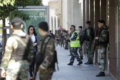 Lebanese soldiers stand guard in front of buildings that house banks Thursday in downtown Beirut. Lebanese troops tightened security around the prime minister's office and other government buildings Thursday as a political crisis deepened over a U.N.-backed tribunal investigating the 2005 assassination of a former prime minister.