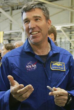 Astronaut Steve Bowen, shown in 2008 at NASA's Johnson Space Center in Houston, is replacing a member of space shuttle Discovery's crew who crashed his bicycle over the weekend.