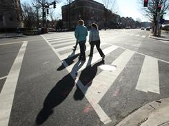 Pedestrians cross Connecticut Ave. in Washington, D.C., in this 2008 photo. Pedestrian deaths have been rising.