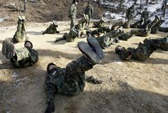 South Korean middle-school students participate in a winter survival camp at a Korean Special Warfare Command in Bucheon, South Korea, on Thursday. New talks between the north and south will get underway, South Korea announced.