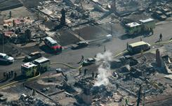 Firefighters sift through rubble after a massive pipeline explosion in September in San Bruno, Calif.