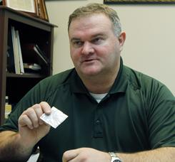 Itawamba County Sheriff Chris Dickinson holds a packet of bath salts on Tuesday at his office in Fulton, Miss. The product, which can be legally purchased, contains stimulants which authorities claim can cause hallucinations, paranoia and suicidal thoughts.