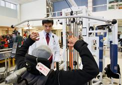 Gerard Francisco, the chief medical officer of TIRR Memorial Hermann Rehabilitation Hospital, talks with patient Luis Gonzales during a media tour of the rehabilitation center gym on Saturday. U.S. Rep. Gabrielle Giffords will undergo rehabilitation treatment at the hospital.