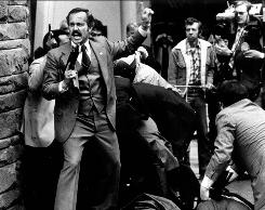 A Secret Service agent reacts after President Reagan is shot outside a Washington, D.C., hotel on March 30, 1981.