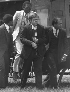John W. Hinckley Jr. arrives in chains at Quantico Marine Base in Virginia on Aug. 18, 1981. He was found not guilty by reason of insanity in the assassination attempt on President Reagan.