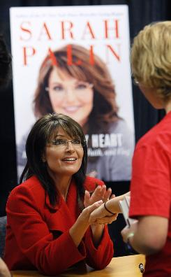 Former Alaska governor Sarah Palin greets a fan during a book-signing event in Iowa in November.