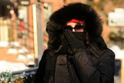A woman walks along Newbury Street braving frigid temperatures Monday in Boston, Massachusetts.